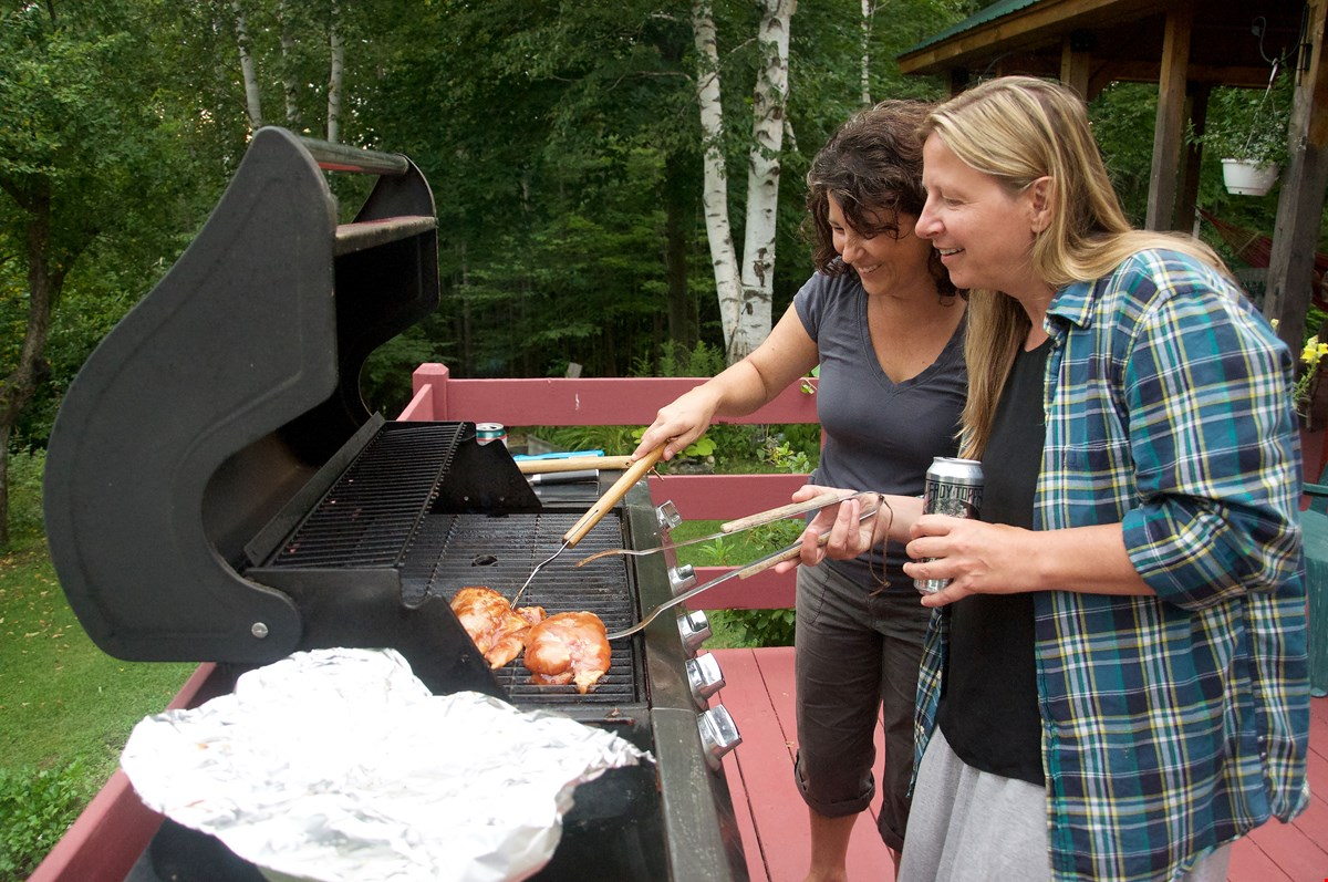2 women grilling with VT beer