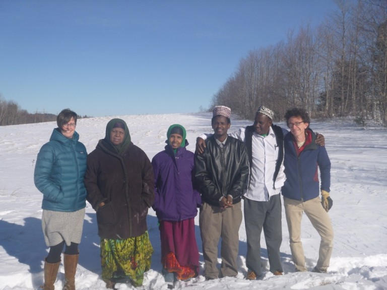 Farmers with MFT and Cultivating Community staff in the snow on the land.