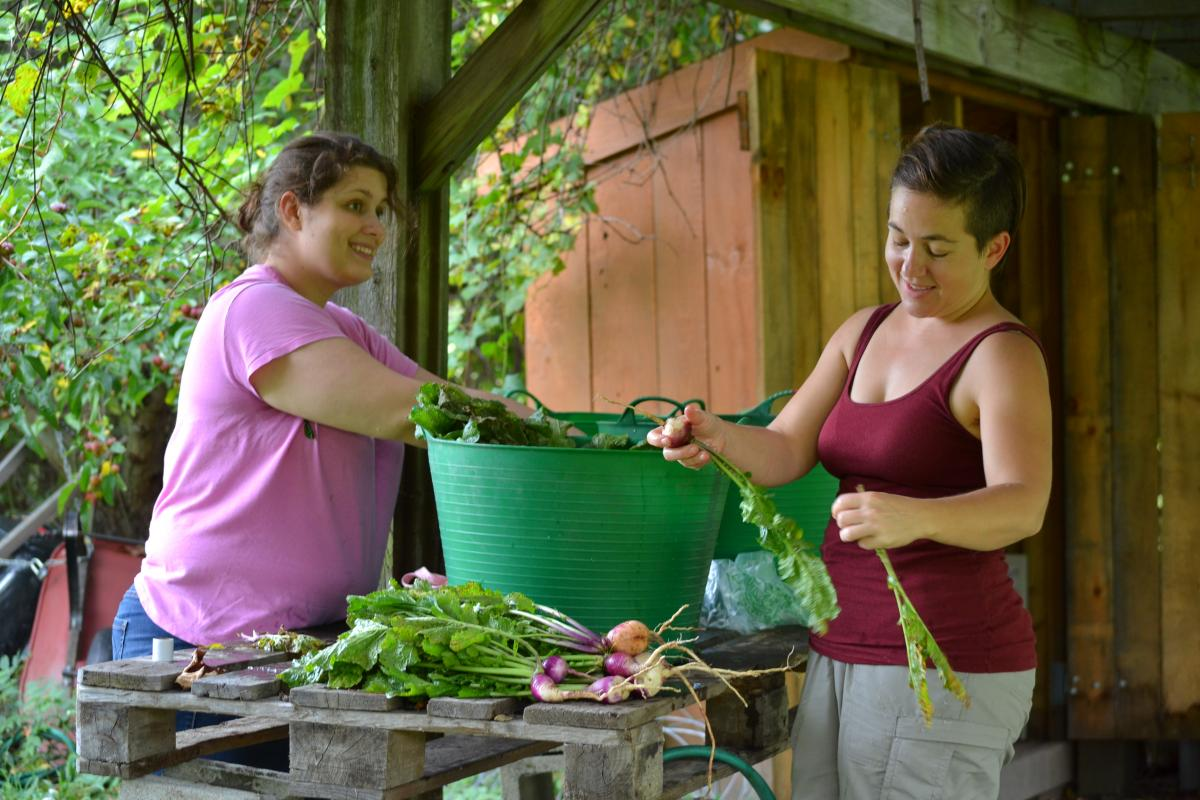 Antioch University New England (AUNE) students Elizabeth Mirra and Rachel Brice at Westmoreland Garden Project
